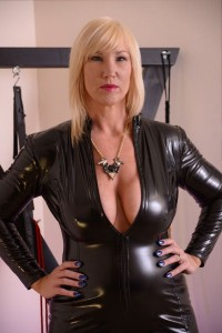 Busty MILF in a black PVC cat suit