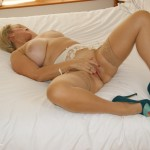 Horny MILF masturbates in her best friends bed