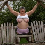 Libby showing he rpink panties in the garden