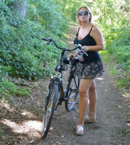Naughty housewife riding a bicycle naked in public