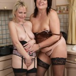 Naughty housewives having dirty fun in the kitchen